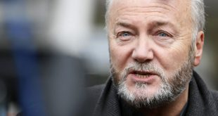 British Member of Parliament George Galloway gives an interview to a television station, as anti-war protesters demonstrate outside the Iraq Inquiry, as former British Prime Minster Tony Blair gives evidence, London , Friday, Jan. 29, 2010. Blair acknowledged Friday that Saddam Hussein didn't become a bigger threat after Sept. 11, but said his perception of the risk posed by terrorists acquiring weapons of mass destruction was dramatically changed by the attacks. (AP Photo/Alastair Grant)